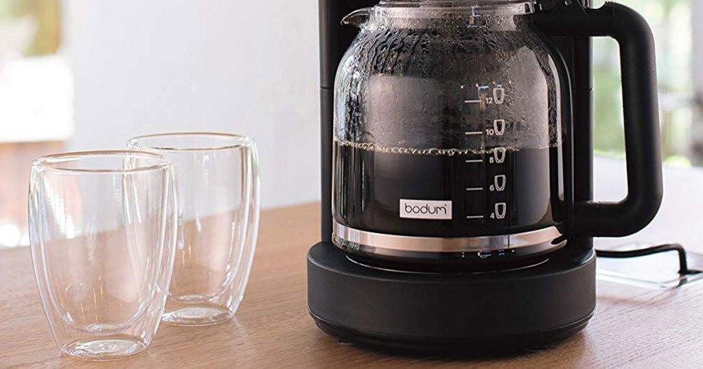 set of 2 Bodum Pavina Glass, Double-Wall Insulate Glass by coffee machine
