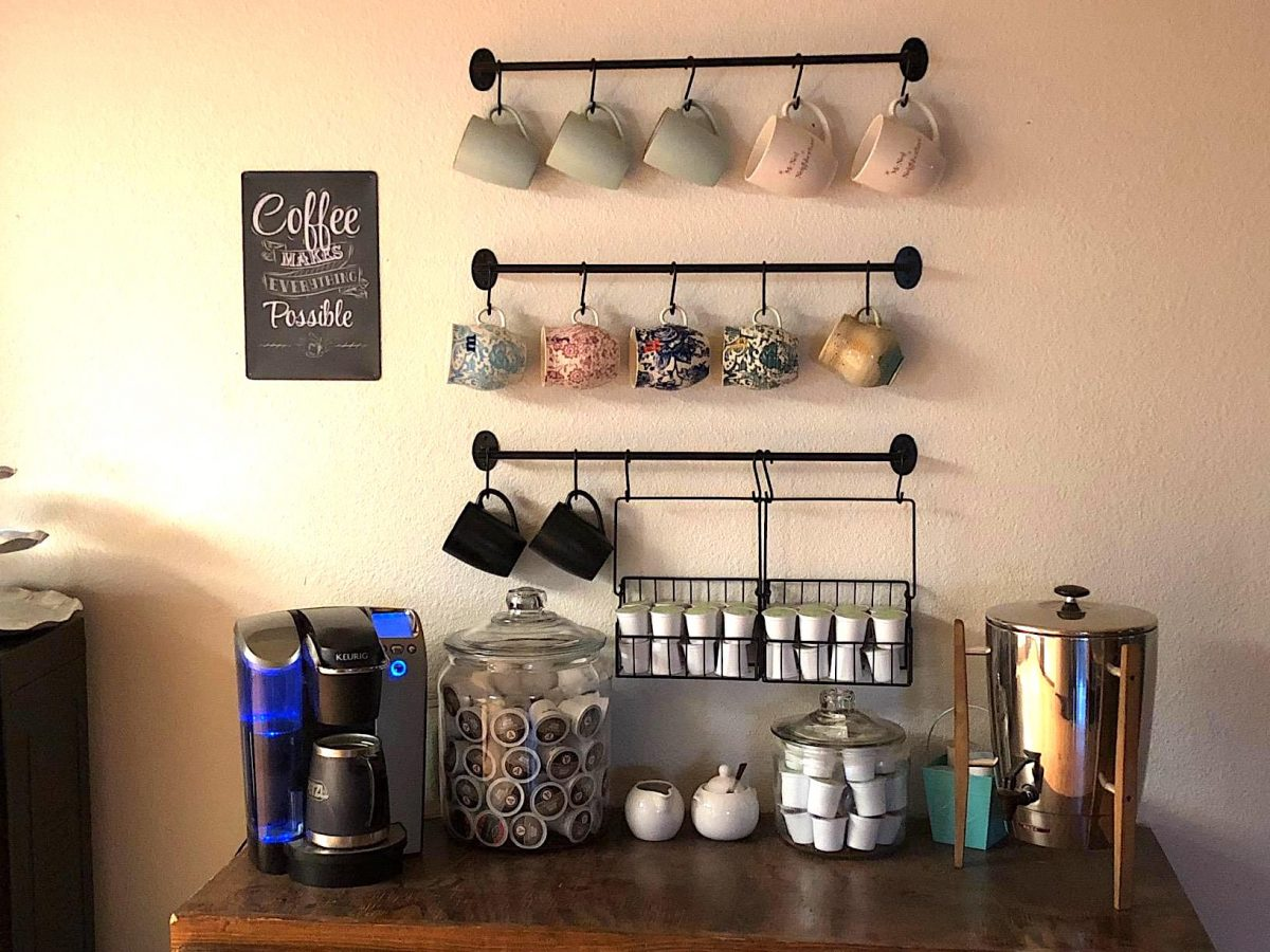 coffee mug wall mount organizer with coffee cups and k-cups in basket and Keurig on counter