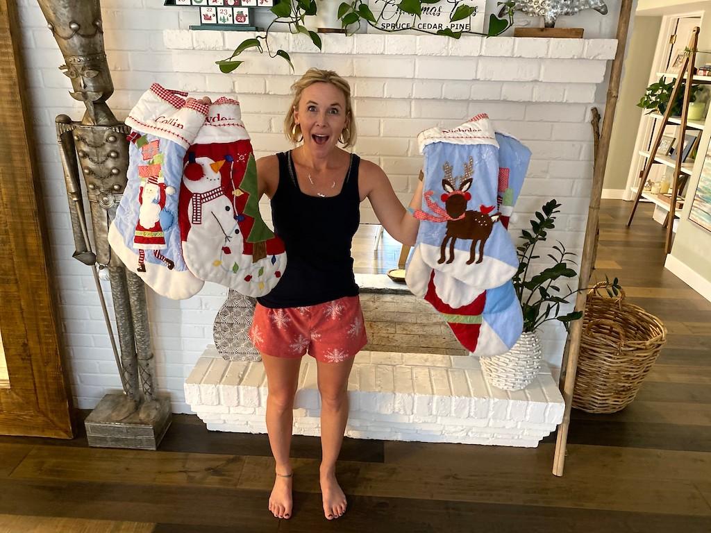 woman holding Christmas stockings