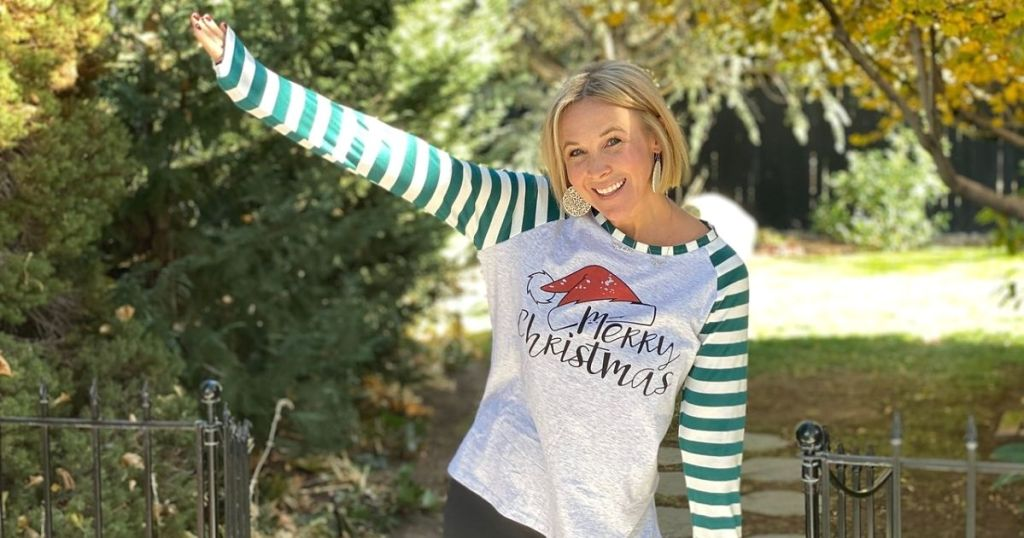 A woman in a Christmas shirt outside