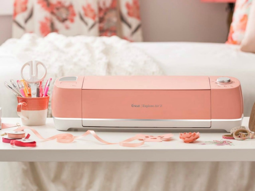 peach colored room with paper cutter and bed