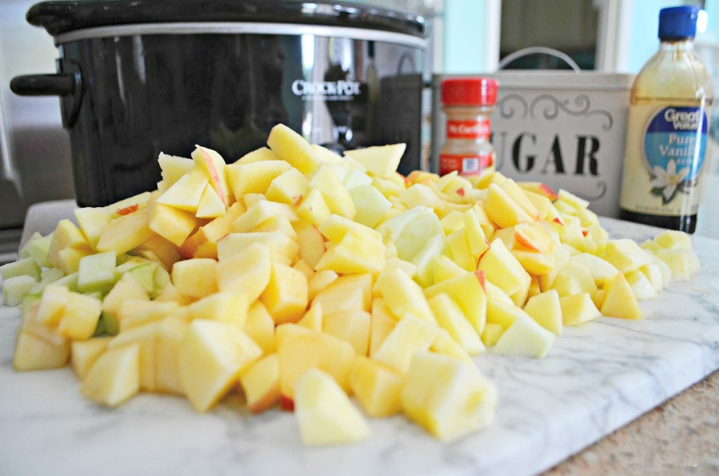 apples sitting in front of a crock pot