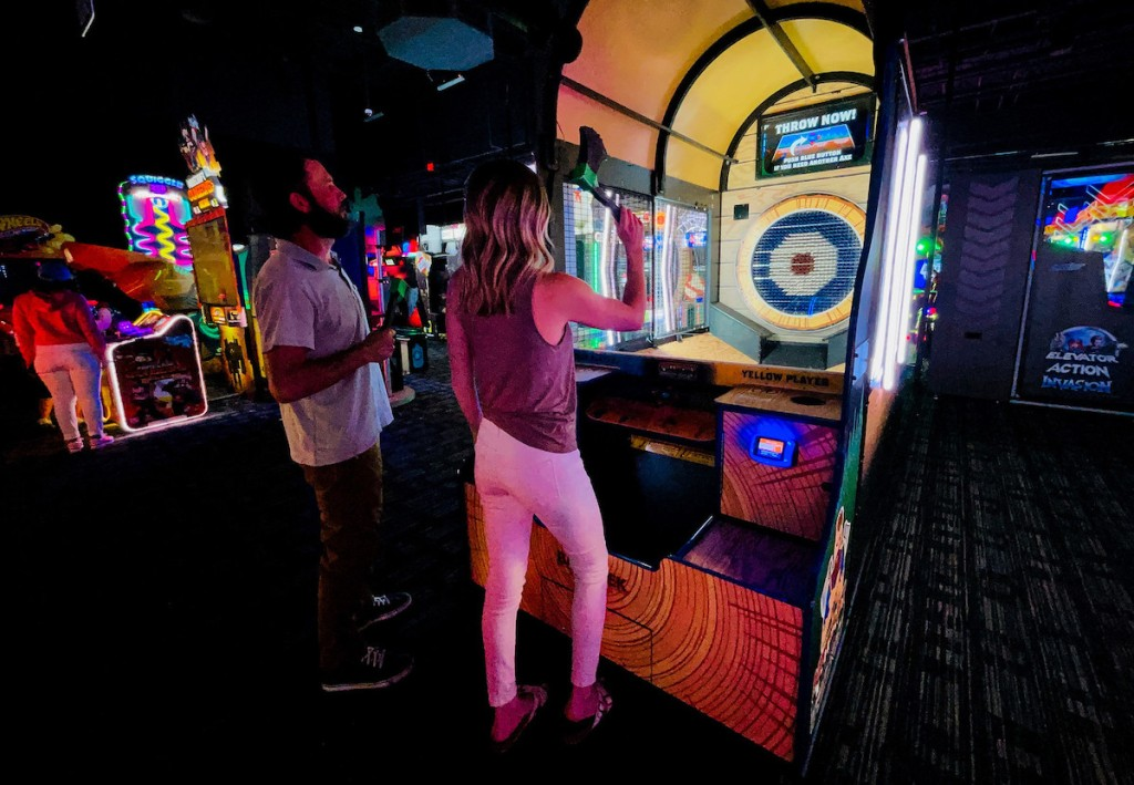 couple playing axe throwing game at Dave and Busters