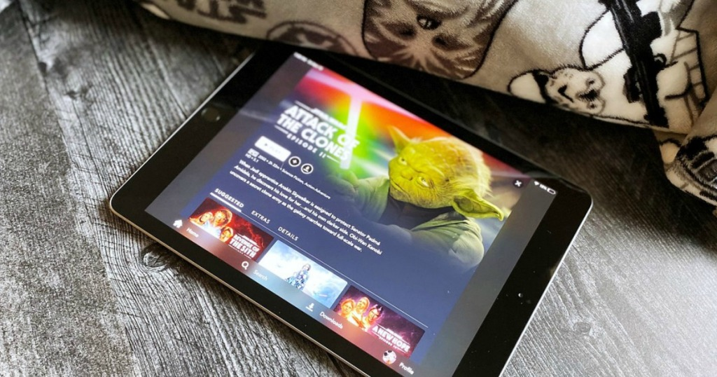 tablet with show playing by blanket