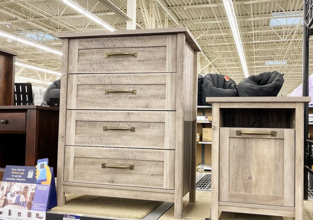 four drawer dresser and nightstand sitting on store shelf