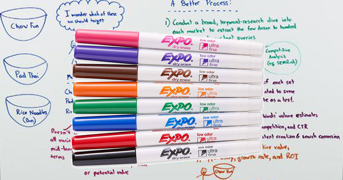 colorful dry erase markers in front of a dry erase board