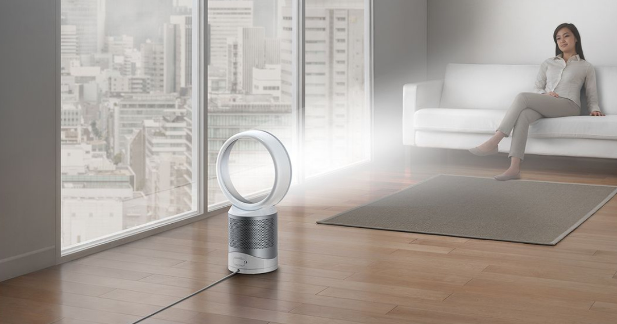 air purifier in living room with woman sitting on couch