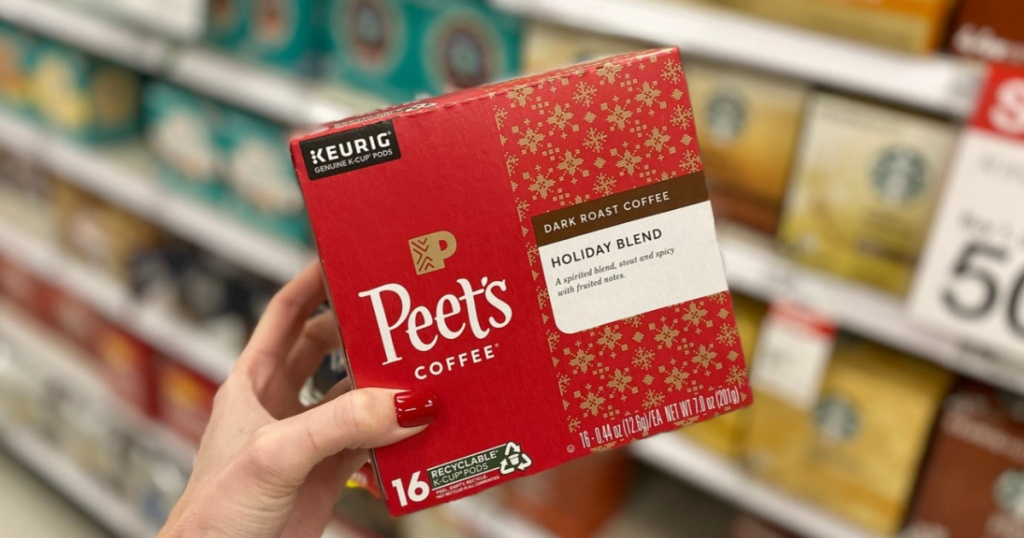 Woman's hand holding Peet's Holiday Blend k-cups at Target