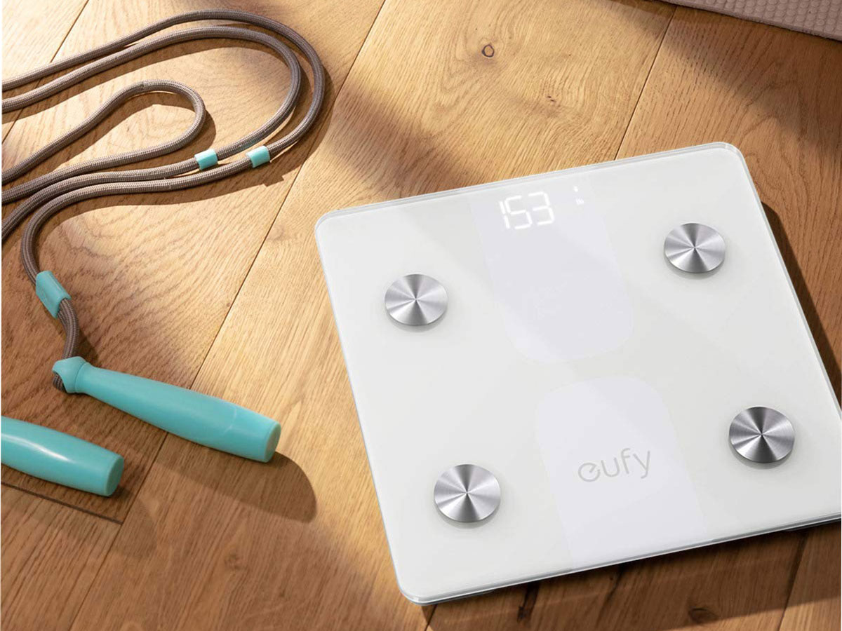 scale on the floor next to a jump rope