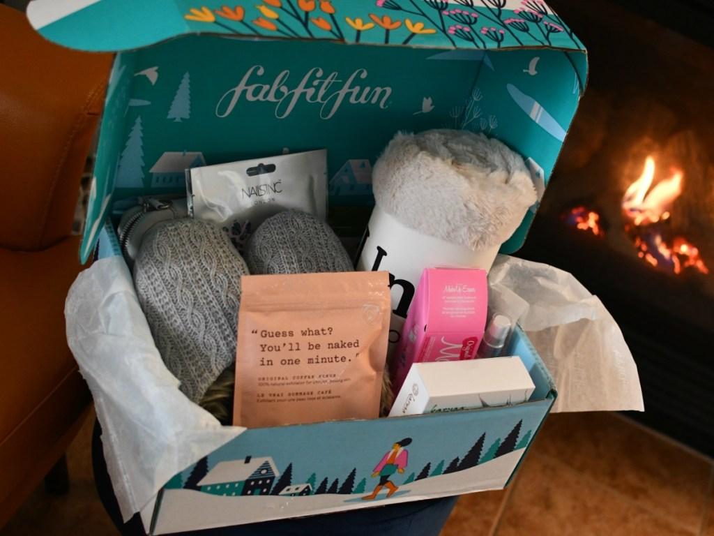fabFitFun Winter Box open with fireplace in background