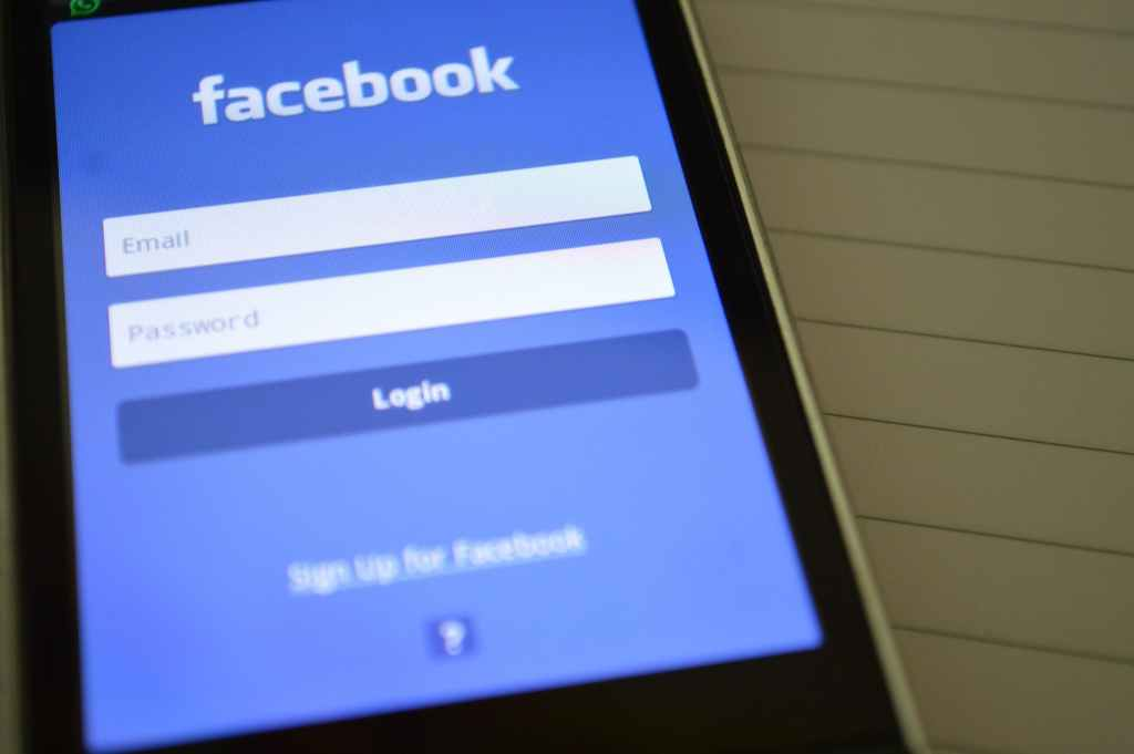 smartphone with Facebook login page on screen
