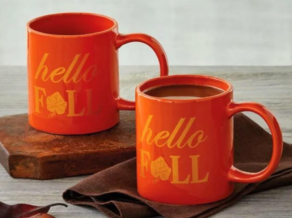 two orange coffee mugs with hello fall