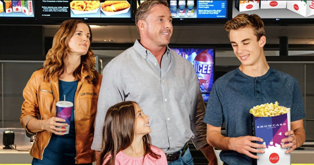 family at the movies buying snacks at the concessions