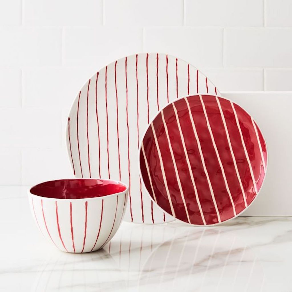 white and red festive stripe dinnerware set with large plate, small plate, and bowl