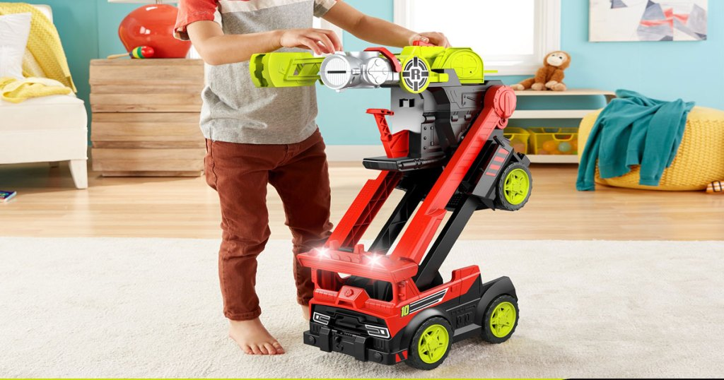boy playing with Rescue Heroes Transforming Fire Truck with Lights & Sounds