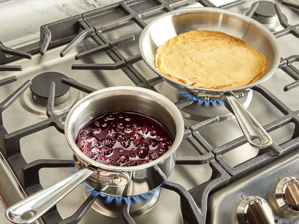 "8"" Fry Pan and 1-quart Sauce Stainless Pan on a stove with food"
