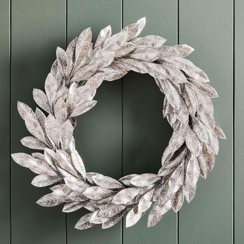 west elm silver glitter leaves wreath on shiplap wall