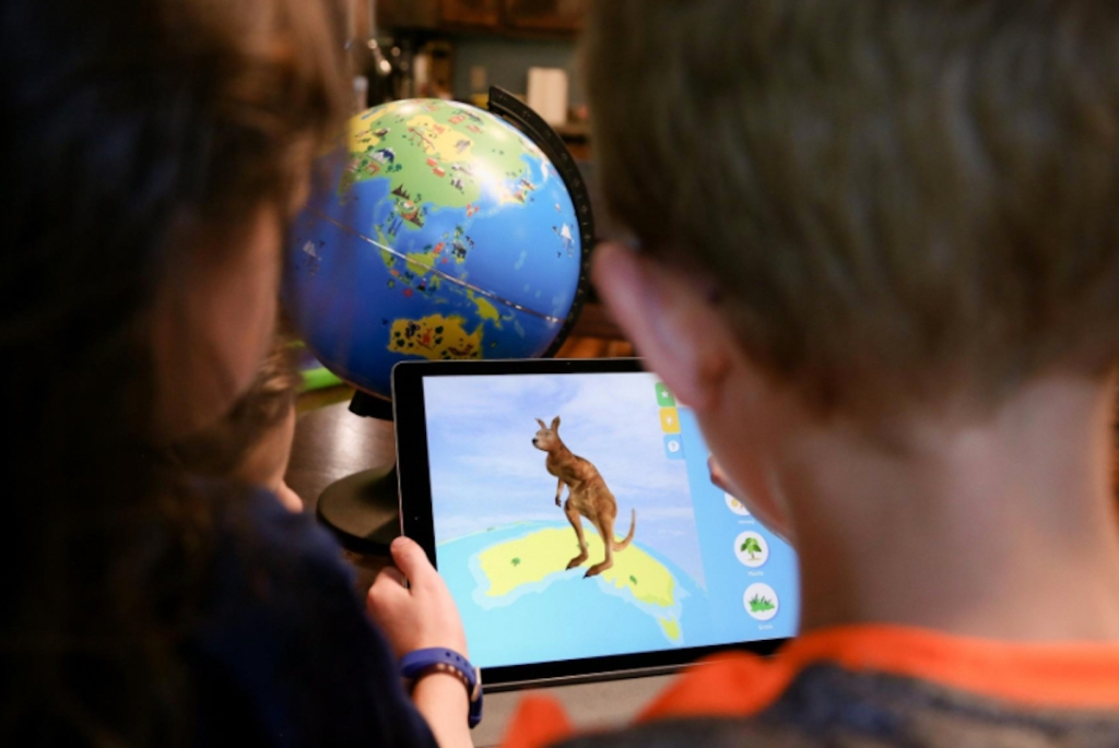 popular kids toys christmas 2020 kids holding ipad in front of interactive globe