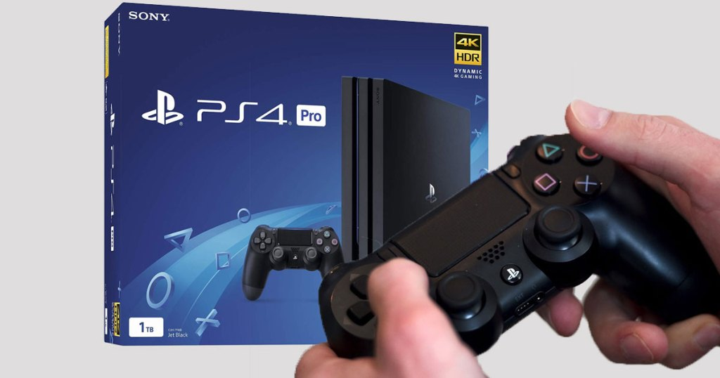 guy holding controller and box of PS4 Pro 1TB