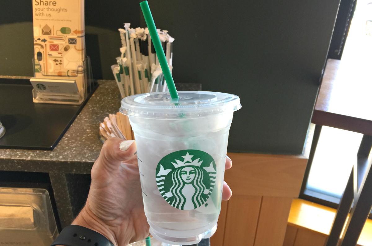 hand holding Starbucks water