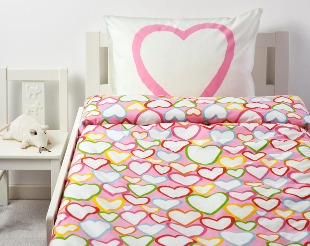 bedroom with pink heart bedding and pillow on bed