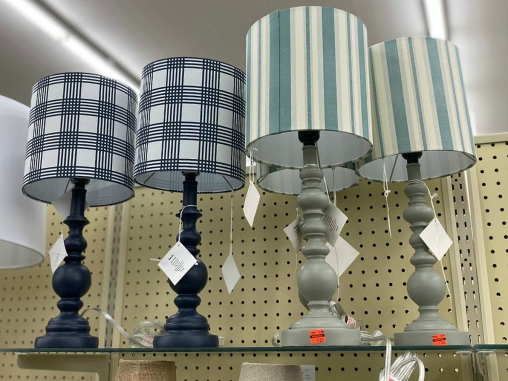 several lamps on display in store
