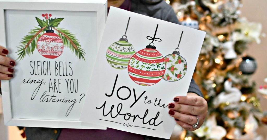 holding free printable christmas prints