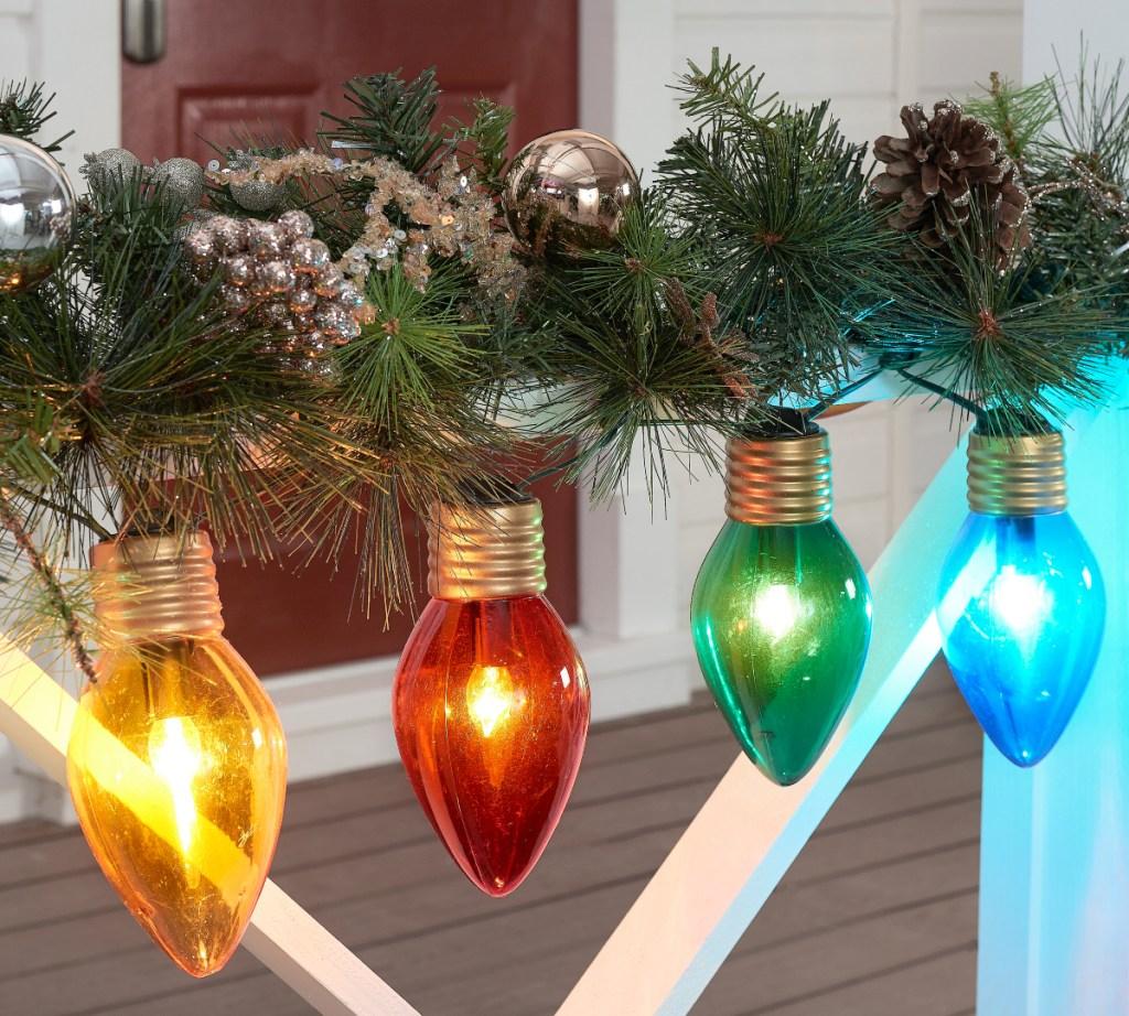Holiday Time Jumbo Lights on porch railing