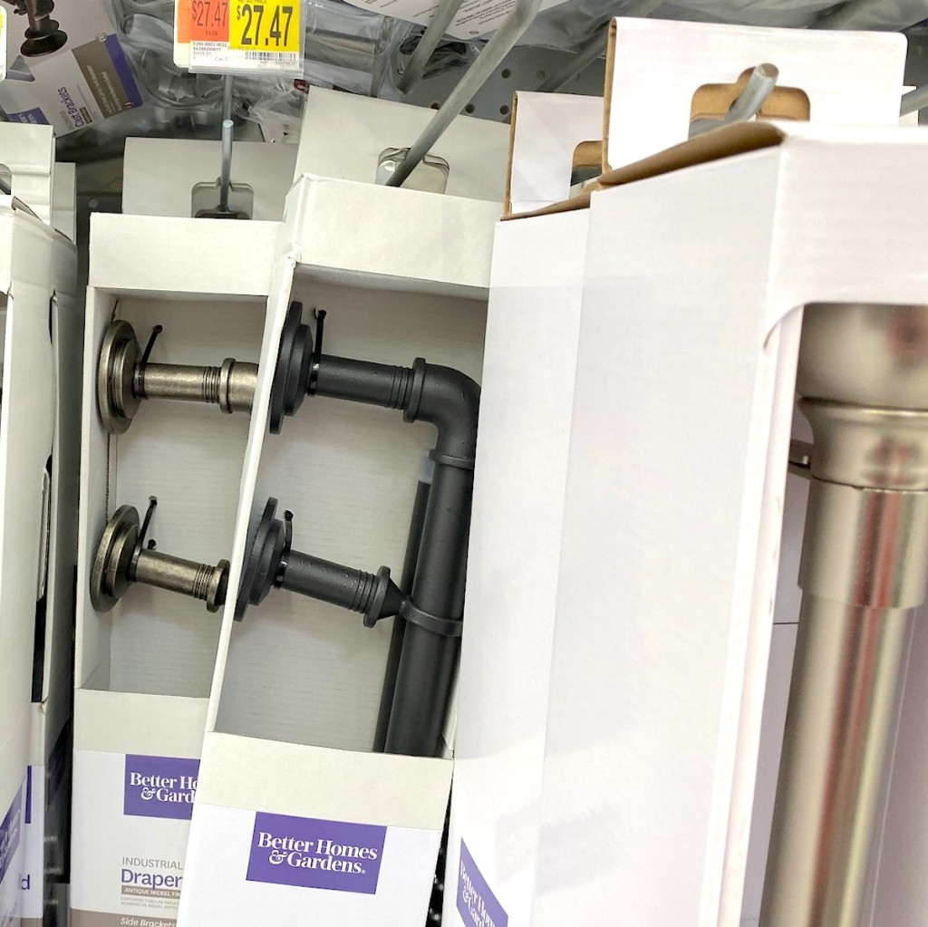 silver and black industrial pipe rods hanging on store shelf