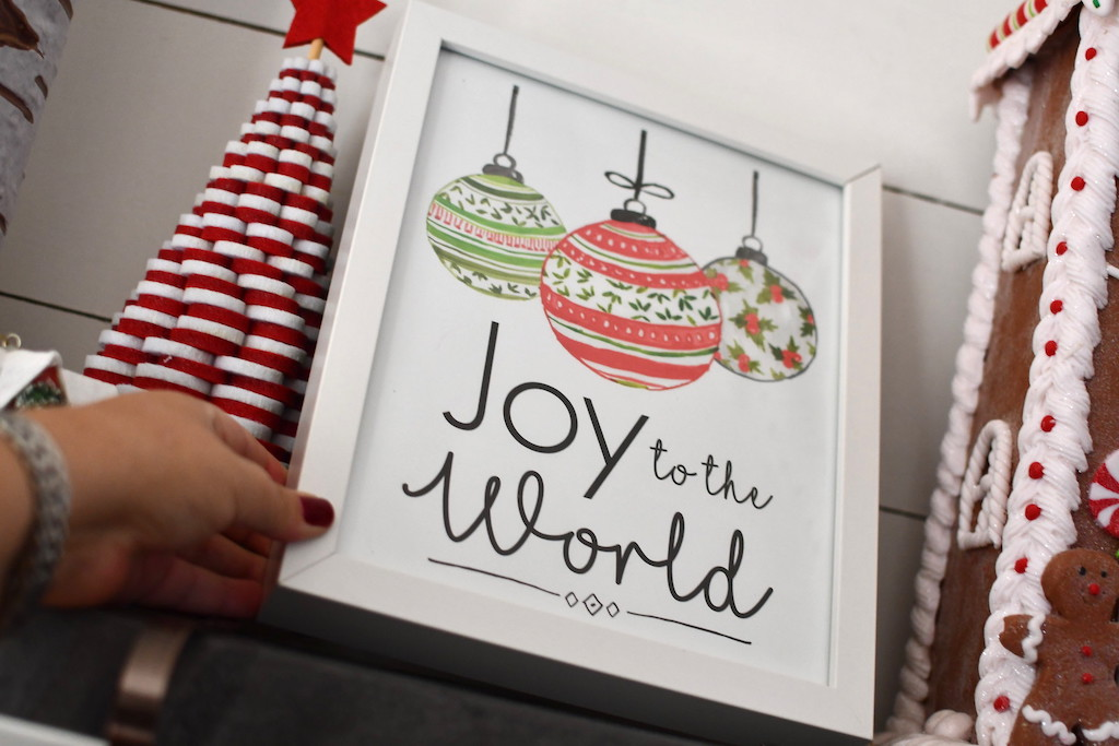 putting joy to the world framed art on shelf