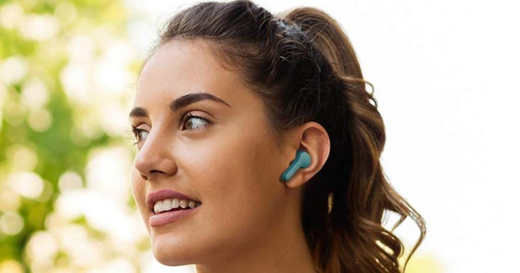 woman wearing jvc gumy earbuds