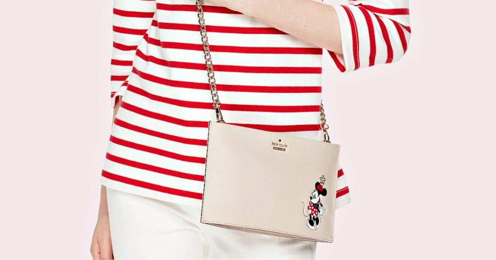woman wearing kate spade clutch bag