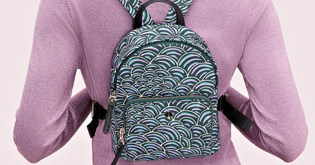 woman wearing kate spade backpack