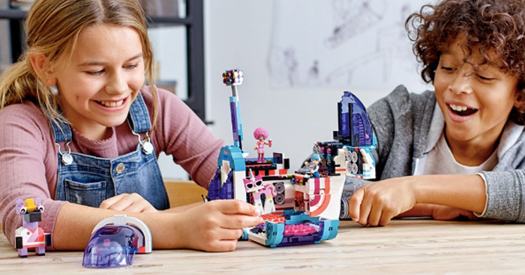 kids playing with LEGO Movie 2 Pop-Up Party Bus