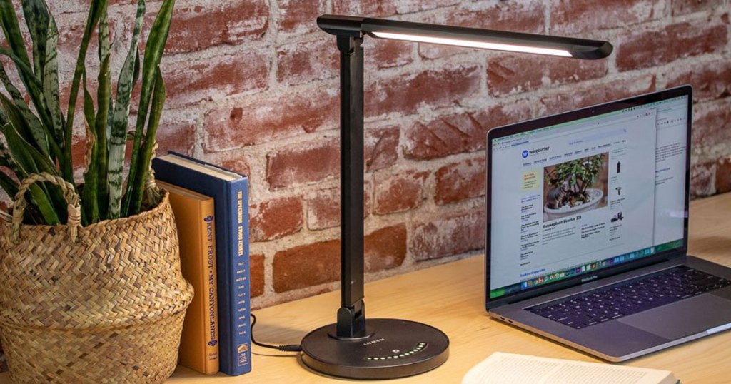 LED Desk Lamp - Dimmable Table Lamp with Eye-Caring on a desk with laptop