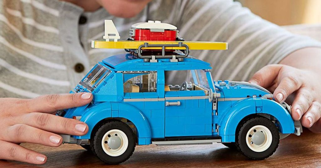 child playing with LEGO Creator Expert Volkswagen Beetle Building Set