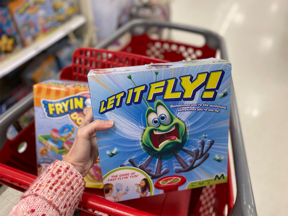 hand holding a maya game of let it fly in a target shopping cart