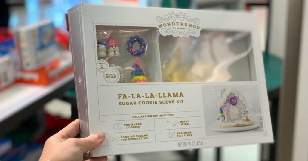 woman holding llama sugar cookie scene kit