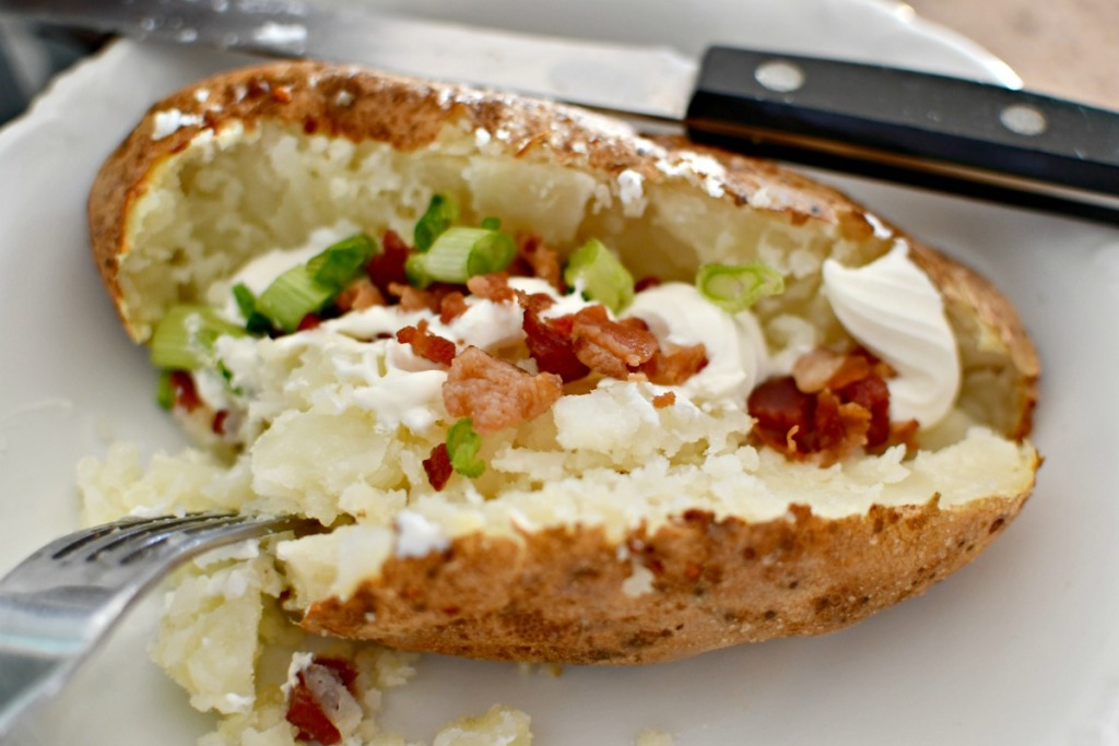 loaded baked potato on a plate