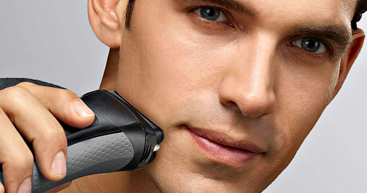man shaving with braun electric shaver
