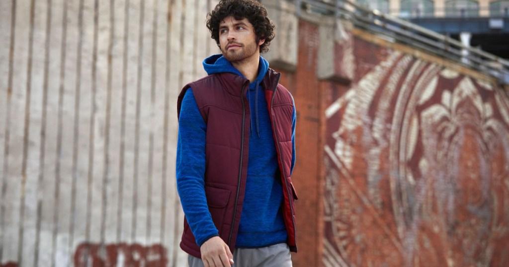 man wearing fleece hoodie and vest