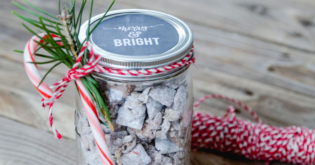 mason jar crafted with puppy chow and a candy cane