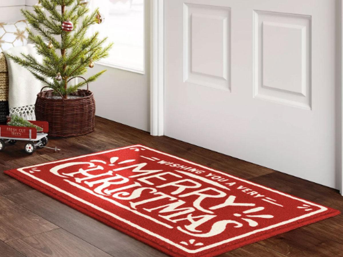 """Wondershop 1'8""""X2'10"""" Merry Christmas Accent Rug Red on the floor by front door"""