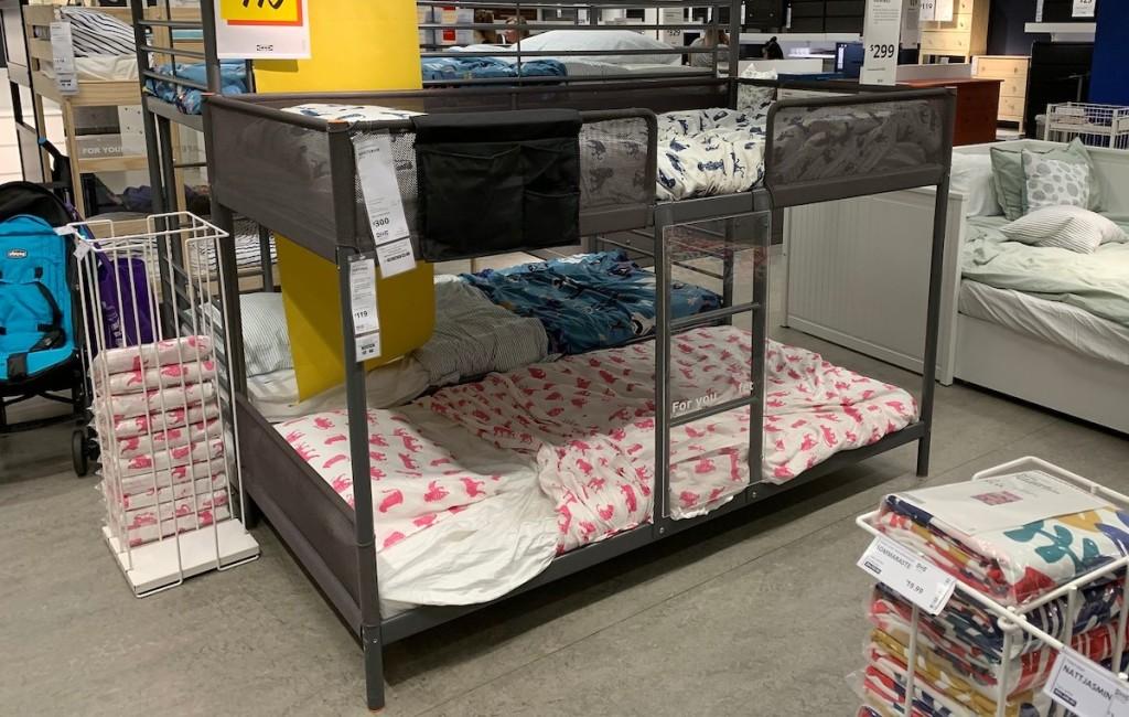 dark gray metal bunk bed sitting in ikea store