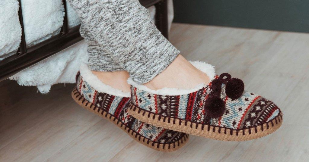 woman wearing a pair of Muk Luks Ballerina Slippers