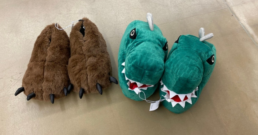 bear and dino slippers on floor