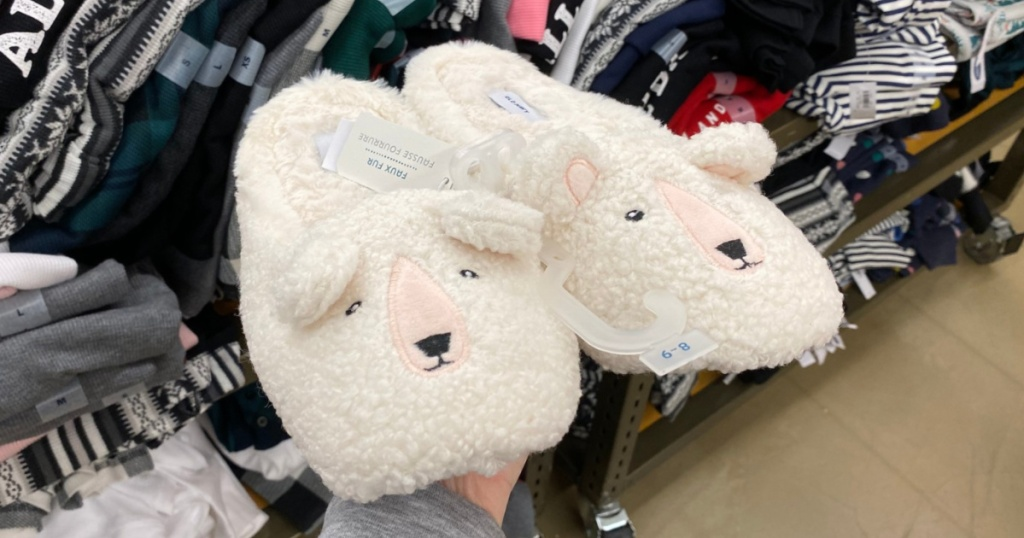 hand holding sherpa slippers in store