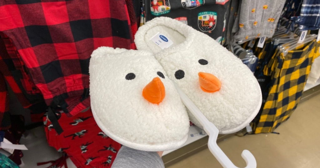 hand holding snowman slippers up in store
