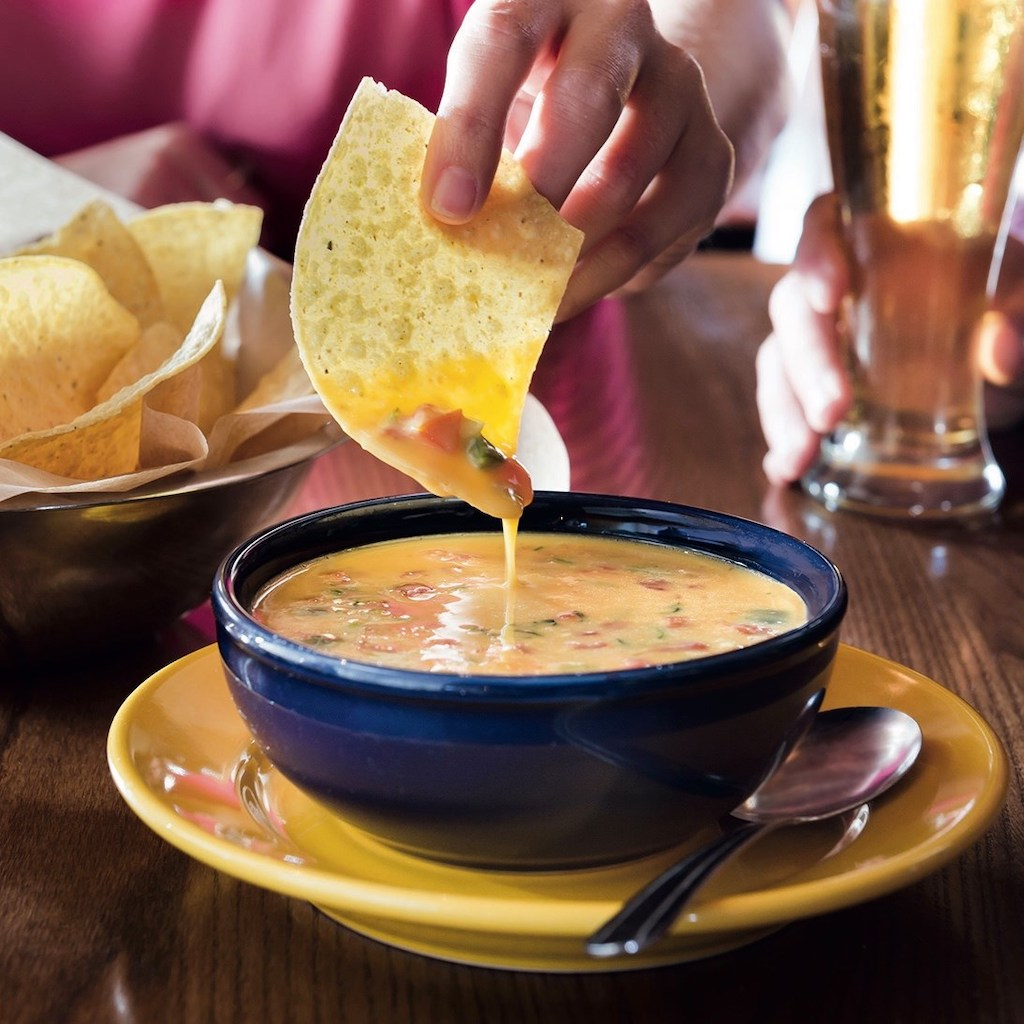 dipping chip in queso at On The Border restaurant