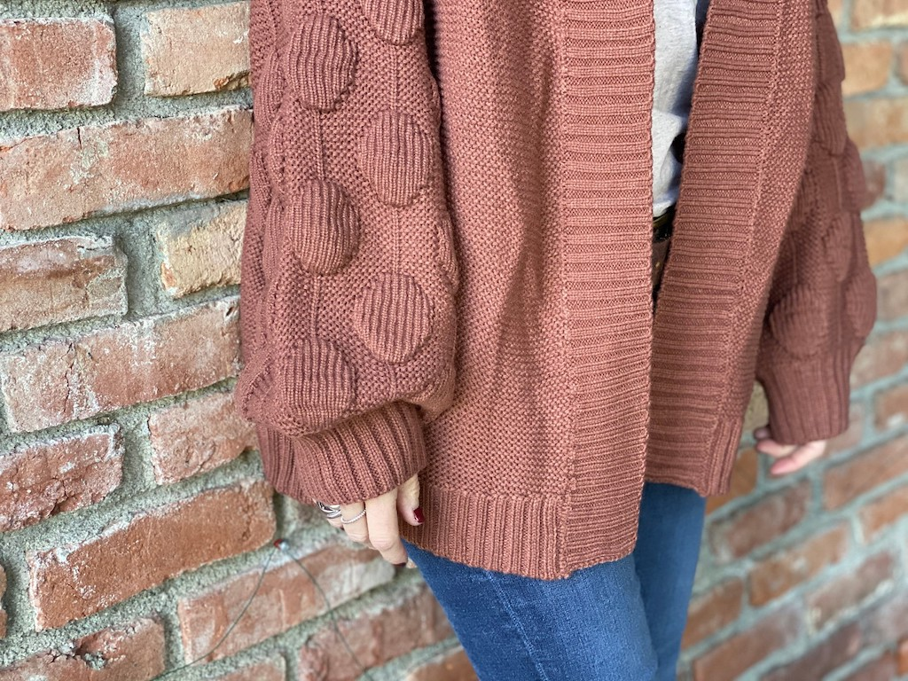 womans oversized cardigan with poms poms